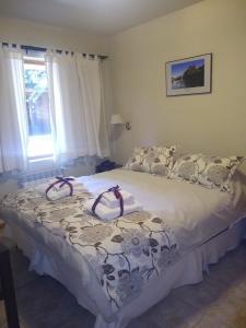 Una cama o camas en una habitación de Las Golondrinas