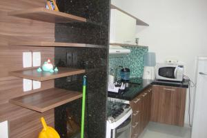 A kitchen or kitchenette at Flats Tuiuiú