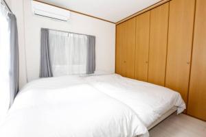 เตียงในห้องที่ GLビルⅢ 4F