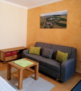 Ein Sitzbereich in der Unterkunft Apartments Haus Morgensonne