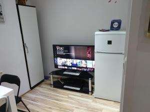 A television and/or entertainment center at Apartment La Mirage