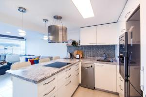 A kitchen or kitchenette at Beach Front Apartment-1st Line
