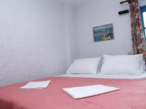 A bed or beds in a room at Joanna Apartments
