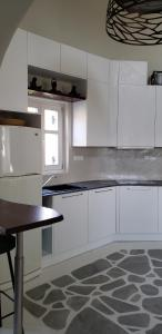 A kitchen or kitchenette at Pleiades Modern Apt With Shared Pool in Ornos!