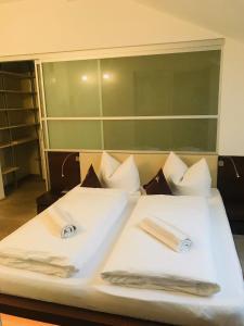 Letto o letti in una camera di Residence Hotel Alpinum