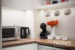 A kitchen or kitchenette at Acropolis Urban Oasis