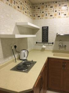 مطبخ أو مطبخ صغير في البوفارديا للأجنحة المفروشة