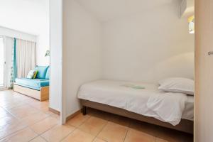 Un ou plusieurs lits dans un hébergement de l'établissement Résidence Pierre & Vacances Les Rivages Du Parc