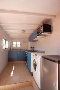 A kitchen or kitchenette at Ramblas Apartments