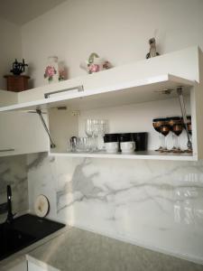 Кухня или мини-кухня в Apartment on Frantsuz'ky Bulvar