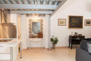 A television and/or entertainment center at ZONA1 CHARMING LOTF NEXT TO ALCAZAR (FREE PARKING)