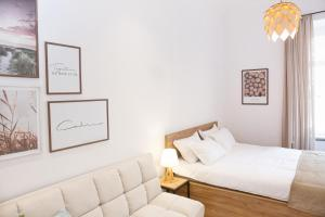 A bed or beds in a room at Cibola Boutique - C