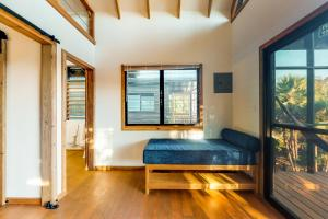 A bed or beds in a room at Inn The Trees Cabañas