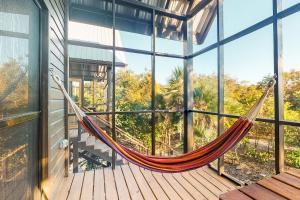 A balcony or terrace at Inn The Trees Cabañas