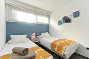 Een bed of bedden in een kamer bij Top Salobre Villas