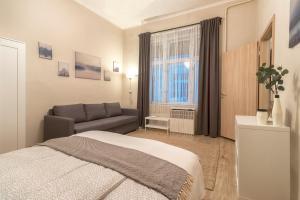 Ein Bett oder Betten in einem Zimmer der Unterkunft Charming apartment close to city centre