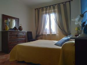 A bed or beds in a room at La Casa tra Gli Ulivi Cottage House