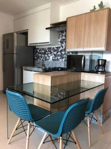 A cozinha ou cozinha compacta de FLAT CUPÊ BEACH LIVING - Beira Mar
