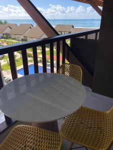 Uma varanda ou terraço em FLAT CUPÊ BEACH LIVING - Beira Mar
