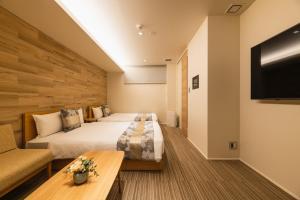 GRAND BASE Yakuinにあるベッド