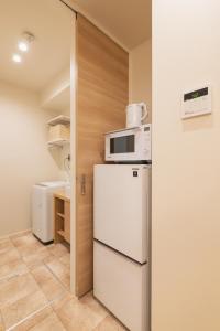 GRAND BASE Yakuinにあるキッチンまたは簡易キッチン