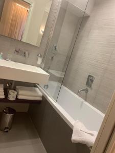 A bathroom at Navona Palace Luxury Inn
