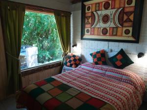 Una cama o camas en una habitación de Aitue Casas De Vacaciones