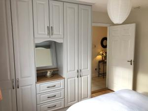 A bed or beds in a room at Cluain Tarbh