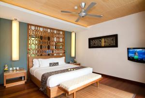 A bed or beds in a room at Maca Villas and Spa