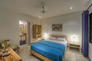 Cama ou camas em um quarto em Tamarindo Garden Boutique Homes