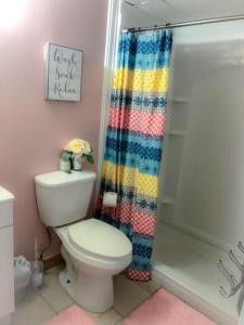 A bathroom at Waikiki Paradise for Families & Friends