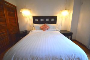 A bed or beds in a room at Villas Sur Mer