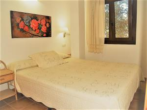 A bed or beds in a room at Apartamentos Turisticos Trajano