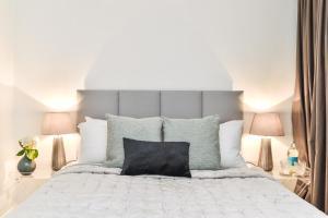 Ein Bett oder Betten in einem Zimmer der Unterkunft 23 Courtfield Gardens