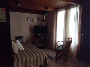 Una cama o camas en una habitación de La Casita de Li