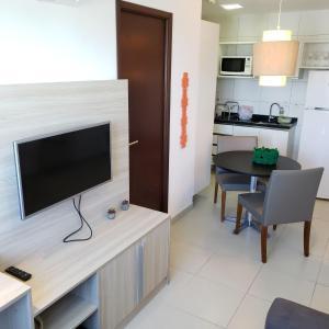 A television and/or entertainment centre at Suites em Boa Viagem