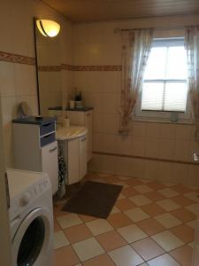 Ein Badezimmer in der Unterkunft Ferienhaus Staben