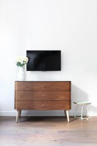 Telewizja i/lub zestaw kina domowego w obiekcie Good Time Apartments Jeżyce
