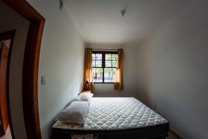A bed or beds in a room at AP espaçoso e PRÓXIMO A TUDO!!