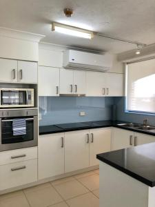 A kitchen or kitchenette at Bougainvillea Gold Coast Holiday Apartments