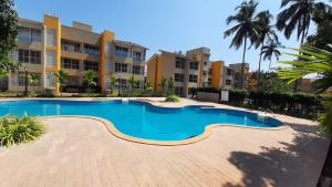 The swimming pool at or close to Elegant 2BHK Poolview Apartment in Anjuna Vagator