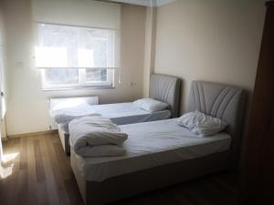 Lova arba lovos apgyvendinimo įstaigoje YAFA Furnished Apartments Trabzon