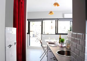 A kitchen or kitchenette at Live in Athens, PSYRRI Central Apartments