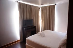 Cama o camas de una habitación en ExMonarca by Design
