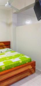 A bed or beds in a room at Mini Departamento Iquitos 1245-01