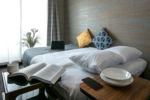 A bed or beds in a room at Randor Residence Kyoto Classic