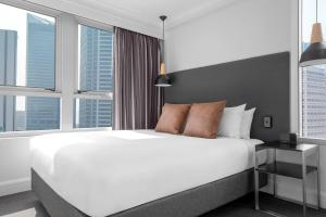 A bed or beds in a room at Mantra on Kent