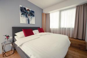 Ein Bett oder Betten in einem Zimmer der Unterkunft Wohnpark Graz-Gösting