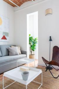A seating area at Olala Diagonal Apartment