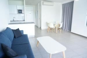 A seating area at Airlie Whitsunday Terraces Resort
